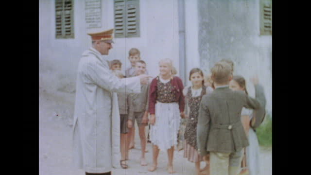 sits and signs autographs / note: from eva braun's home movie collection - adolf hitler stock-videos und b-roll-filmmaterial