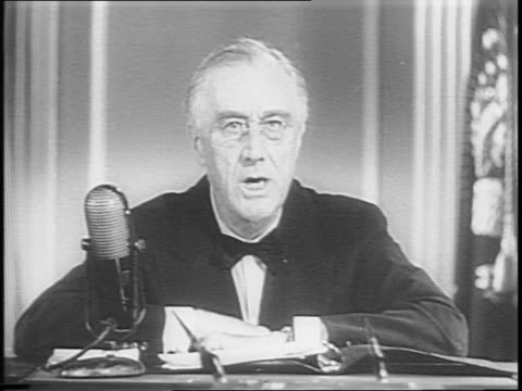 fdr sits at desk addresses the nation / urges citizens to contribute to the national war fund - anno 1944 video stock e b–roll