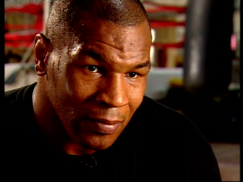 grn sits down for an interview with mike tyson on reporter's question what would you like to do while retired spend time with your family outside of... - {{asset.href}} stock videos & royalty-free footage