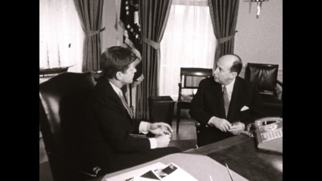 jfk sits in oval office at desk with unknown man - adlai stevenson ii stock videos and b-roll footage