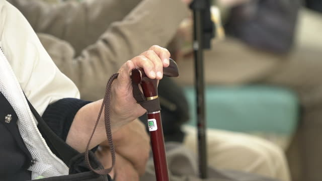sitting aged person with stick, tokyo, japan - walking stick stock videos & royalty-free footage