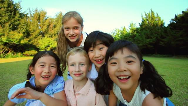 ms sitting childrens smiling and looking / paju, gyeonggido, south korea - 表情点の映像素材/bロール
