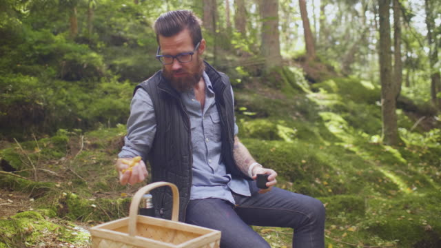 sitting down for a coffee break in the forest - coffee drink stock videos & royalty-free footage