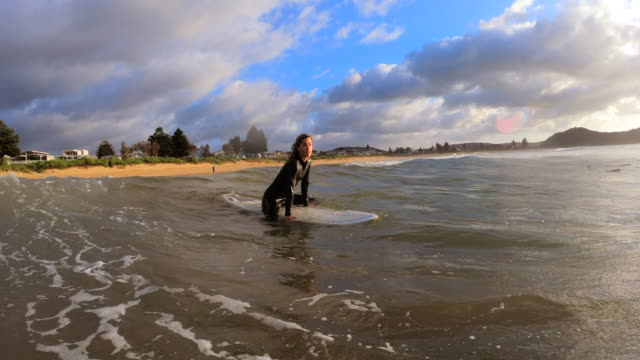 sitting on a surfboard - wetsuit stock videos & royalty-free footage