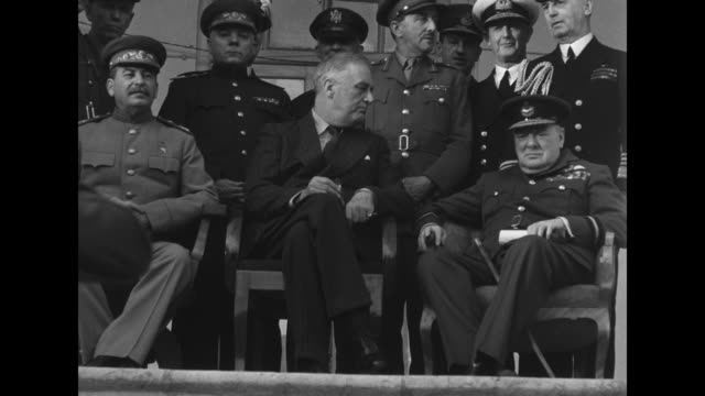 sitting on porch of soviet embassy posing for photo opportunity left to right soviet premier joseph stalin us president franklin roosevelt and... - government building stock videos & royalty-free footage