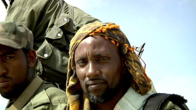 sitting on the back of a pick-up truck and holding guns somali militia men on july 31, 2011 in dhoobley, somalia - somalia stock videos & royalty-free footage