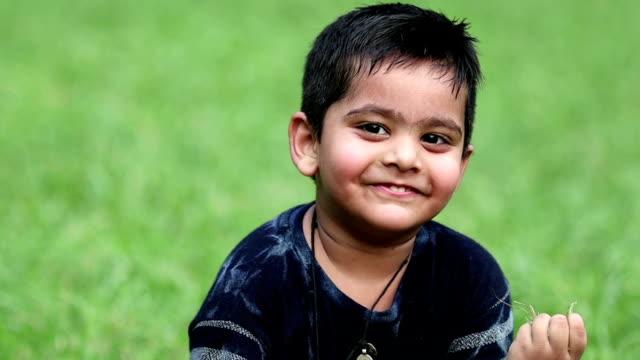 sitting portrait of little boy - video portrait stock videos & royalty-free footage