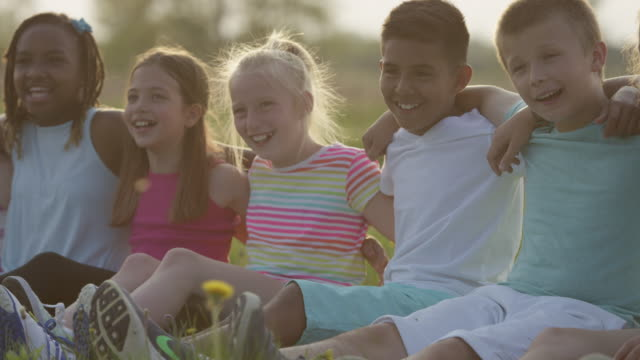 sitting with friends - pre adolescent child stock videos & royalty-free footage