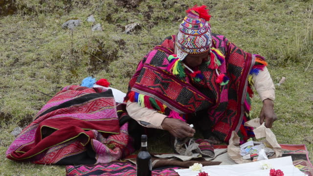 MS Sitting woman in traditional dress / Cuzco or Cusco, Peru