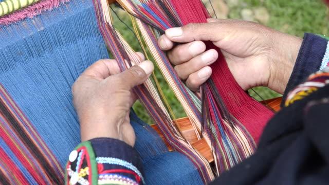 CU ZO Sitting woman weaving yarn / Cuzco or Cusco, Peru