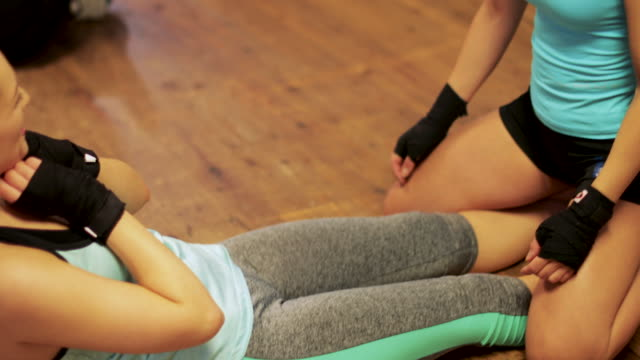 sit-ups with friends - kickboxing stock videos and b-roll footage