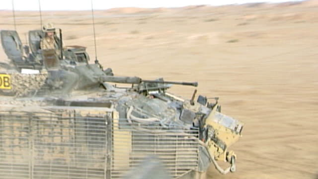 total death toll passes 400 iraq near basra warrior tank along - basra stock-videos und b-roll-filmmaterial