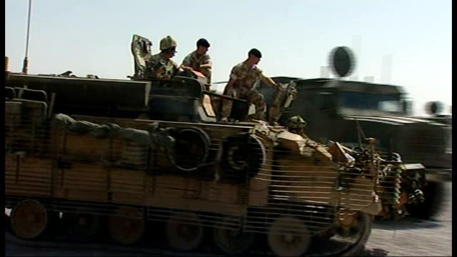 total death toll passes 400 file r21080803 / 2182008 camp bastion bulldog armoured personnel carrier along through camp british soldiers seated on... - armoured personnel carrier stock videos & royalty-free footage