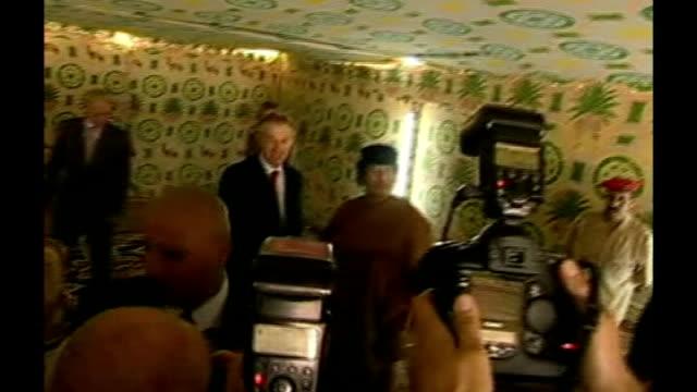 six bulgarian medics convicted of infecting libyan children with hiv freed; lib libya: sirte: int **beware flash photography** tony blair mp in tent... - retrovirus stock videos & royalty-free footage