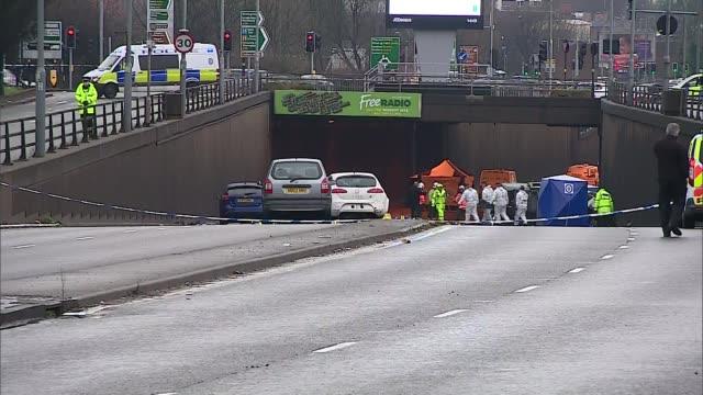 Six dead in Birmingham multi vehicle crash ENGLAND West Midlands Birmingham EXT Long shot of cordonedoff crash scene in road underpass police...