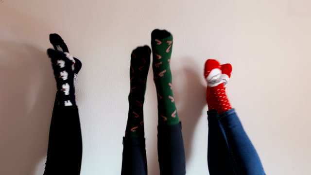 six female legs in socks of different color, close-up, on a brick wall background - number 6 stock videos & royalty-free footage