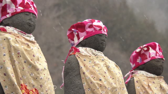 cu, six jizo statues in snow, fukushima, japan - memorial event stock videos & royalty-free footage