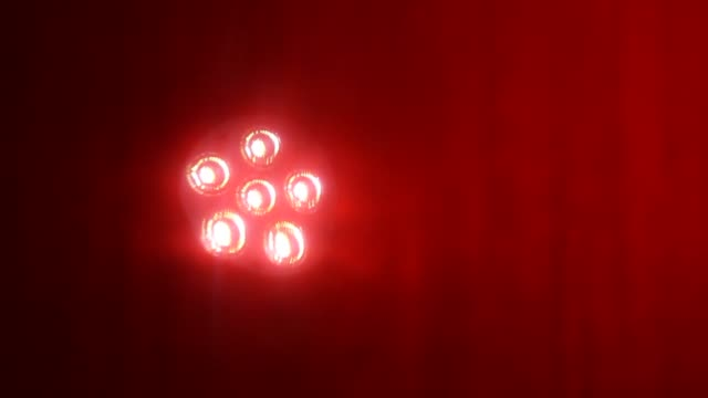 six led lights moving on red background - mirror object stock videos & royalty-free footage