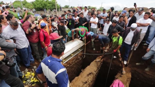 Six members of a single family whose home was burned down after a group of hooded armed men threw a Molotov cocktail are laid to rest in a cemetery...