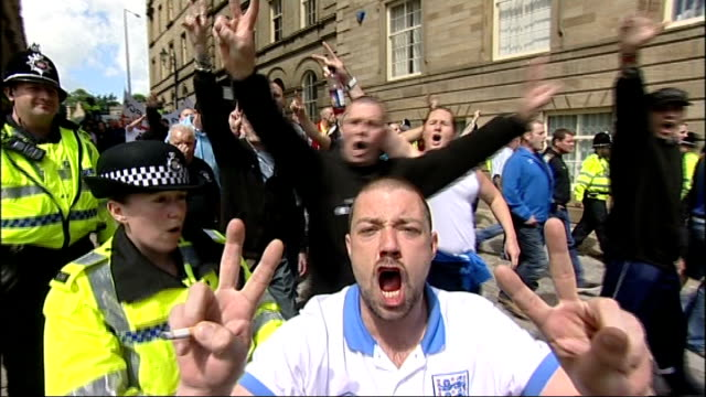 six men plead guilty to planned bomb attack on edl rally in dewsbury; file: 30.6.2012: england: west yorkshire: dewsbury: ext english defence league... - west yorkshire stock videos & royalty-free footage