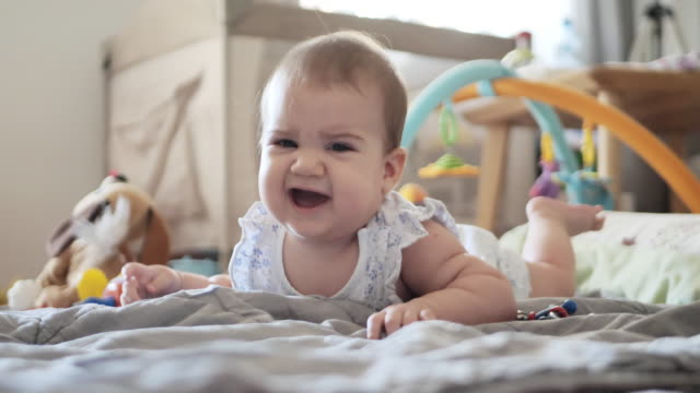 six month old baby girl is about to cry, video 60 fps - only baby girls stock videos & royalty-free footage