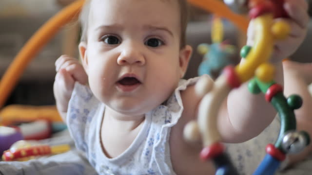 six month old baby girl - brown eyes stock videos & royalty-free footage