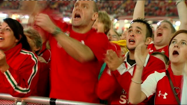 six nations championship 2013: preview; / t15101103 wales: cardiff: millennium stadium: wales supporters cheering wales try as watching 2011 world... - 準決勝点の映像素材/bロール