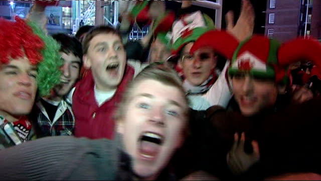 england beat wales wales cardiff millennium stadium photography *** wales rugby fans wearing hats and scarves singing sot fans with welsh flag... - neckwear stock videos and b-roll footage
