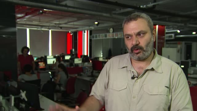six thousand people under arrest as erdogan regains control aliser delek interview sot various shots people working in cnn turk studio - cnn stock videos & royalty-free footage