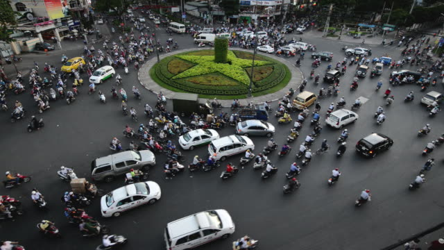 six way junction in ho chi minh city, vietnam - chaos stock-videos und b-roll-filmmaterial