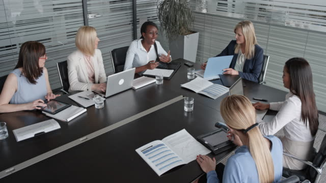 cs six women of different ethnicity in a project meeting in the conference room - blocco per appunti video stock e b–roll