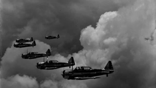 six wwii advanced trainer aircraft fly in close formation. - military training stock videos & royalty-free footage