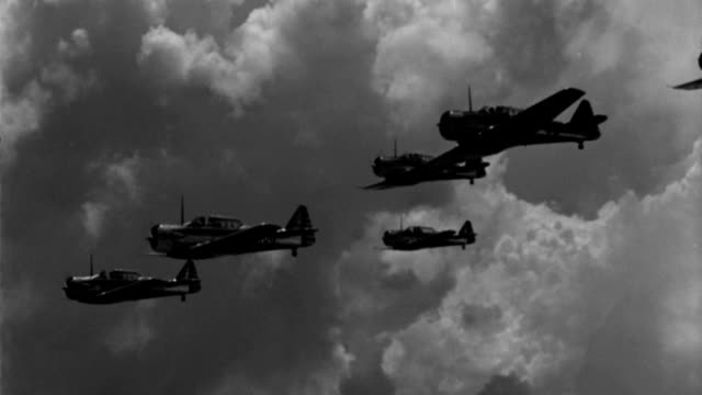 six wwii advanced trainer aircraft pull into echelon formation in a cloudy sky. - military training stock videos & royalty-free footage