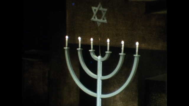 a six-armed menorah alight inside a synagogue; 1968 - religious equipment stock videos & royalty-free footage