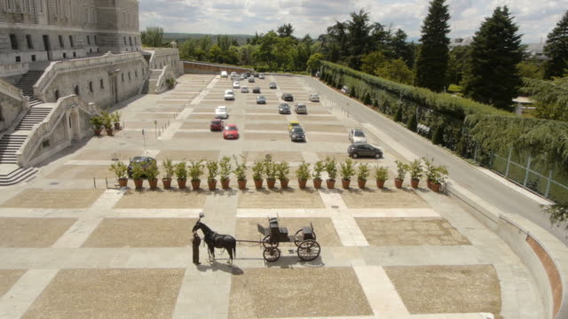 six-horse-carriage prepared in front of palace in madrid, spain - palace stock videos & royalty-free footage