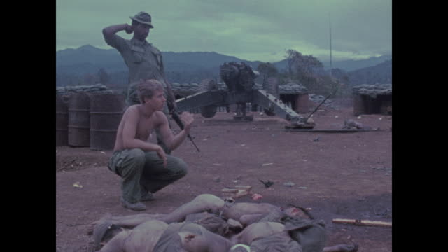 sixteen north vietnamese commandos died in this august 1970 attack on the kham duc artillery base near the ho chi minh trail three americans died /... - vietnamkrieg stock-videos und b-roll-filmmaterial