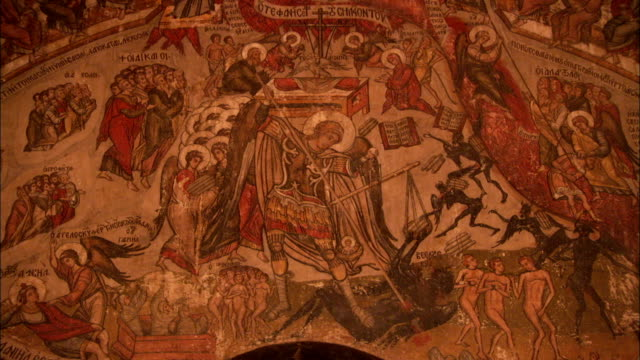 Sixteenth-century painted murals depict Christian imagery inside Saint Catherine's Monastery in Mount Sinai Egypt. Available in HD.