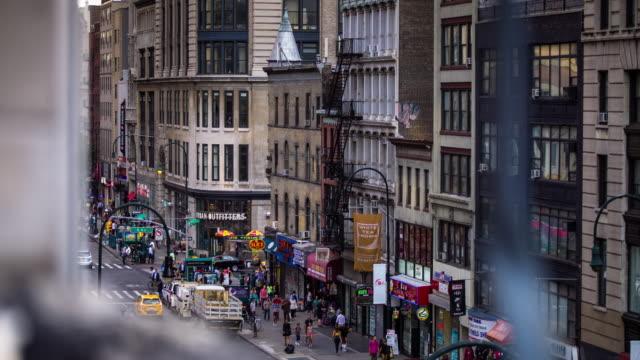sixth avenue and 14th street, manhattan - time lapse - chelsea manhattan video stock e b–roll