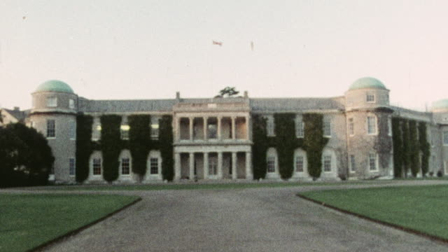 1975 montage sixth-form history students visiting goodwood house, with the van driving up the long lane to the estate / england, united kingdom - goodwood house stock videos & royalty-free footage
