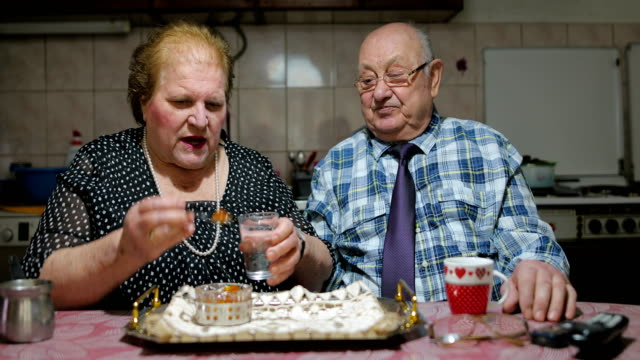 sixty years together.senior couple sharing candied fruit - married stock videos & royalty-free footage