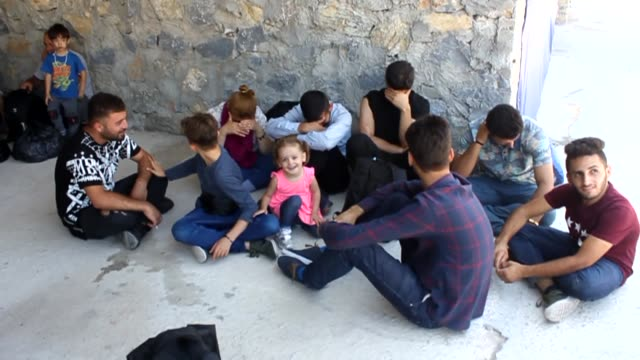 stockvideo's en b-roll-footage met sixtythree undocumented migrants were rounded up in ezine district of northwestern canakkale province on july 05 2018 as they attempted to illegally... - vluchteling ontheemden