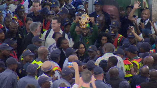 siya kolisi, south african captain, holds the rugby union world cup trophy aloft as the team arrives back home at tambo international airport in... - south africa stock videos & royalty-free footage