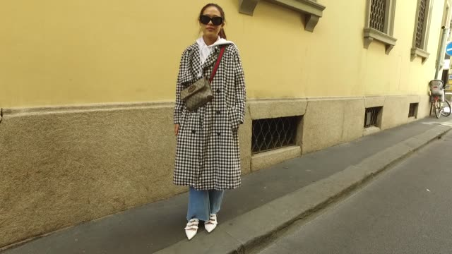 Siyan Chen wearing Topshop coat Champion hoodie Zara jeans korean shoes Gucci bag and Céline sunglasses is seen during Milan Fashion Week...