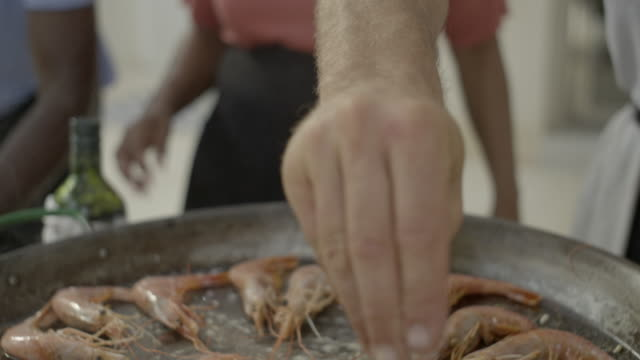 sizzling prawns are seasoned with salt - seafood stock videos & royalty-free footage