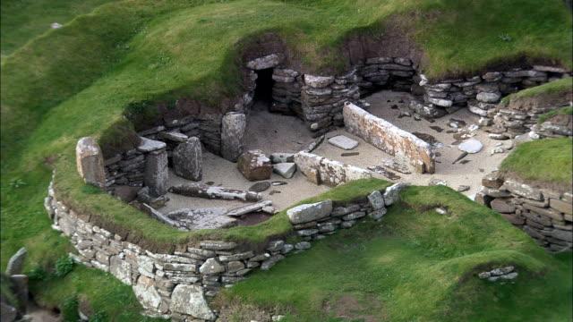 skara brae pre-history stone village  - aerial view - scotland, orkney islands, united kingdom - cliff dwelling stock videos & royalty-free footage