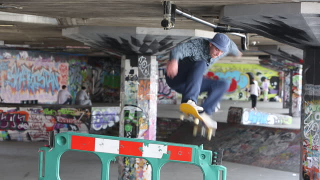 skate boarders practising on london's south bank, london, uk. - stunt stock videos & royalty-free footage