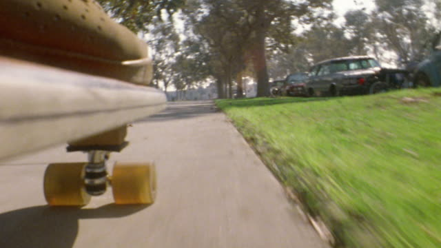 1976 skateboard point of view moving on suburban sidewalk - 1976 stock videos & royalty-free footage