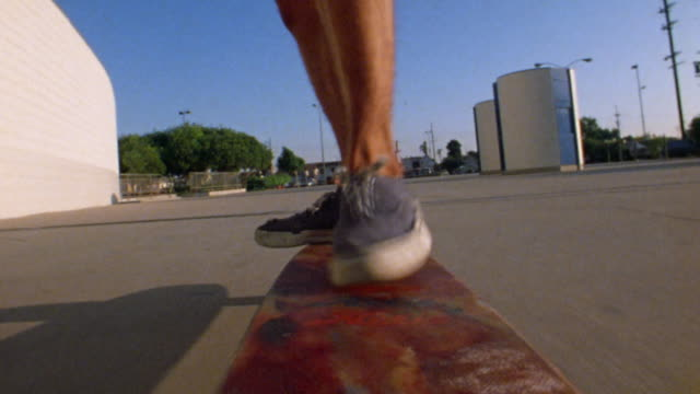 1976 fast motion skateboard point of view skateboarder moving feet on board / doing handstand in parking lot - footwear stock videos & royalty-free footage