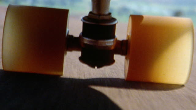 vidéos et rushes de 1976 skateboard wheels point of view rolling over street - 1976