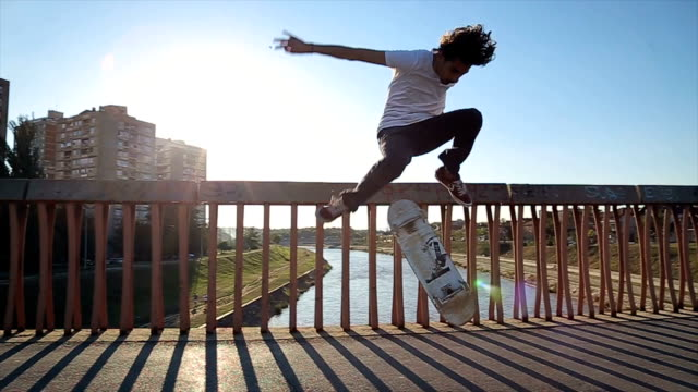 skateboarder doing a skateboard trick - ollie - sporting term stock videos & royalty-free footage